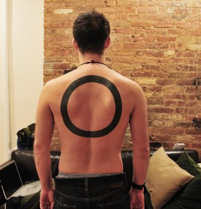 large-circle-tattoo-on-back
